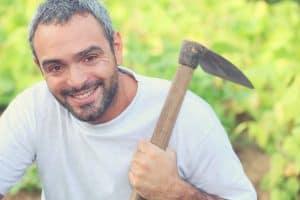 gardener with garden hoe