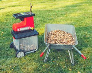 leaf mulcher and leaves in the garden